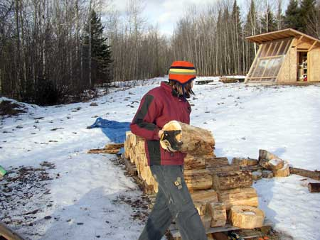 Clare (and her hat) moving logs
