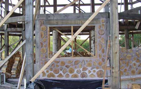 A panel of amateur cordwood enthusiasts